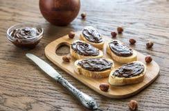 Fette di baguette con la crema del cioccolato Immagine Stock Libera da Diritti