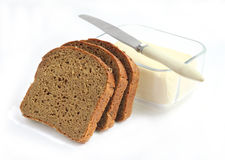 Fette di pane e di burro della segale Fotografia Stock