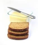Fette di pane e di burro della segale Fotografie Stock