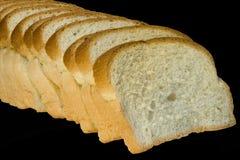 Fette di pane isolate sul nero fotografie stock libere da diritti