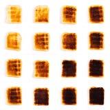 Fette di pane tostato su un fondo bianco Fotografie Stock Libere da Diritti