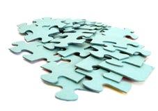Fette di puzzle su una priorità bassa bianca Fotografia Stock Libera da Diritti