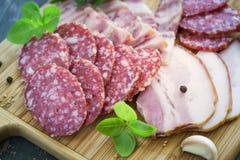 Fette di salame e di bacon, fuoco selettivo Immagine Stock Libera da Diritti