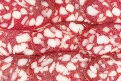 Fette di salame Fondo taglio della salsiccia fotografia stock