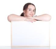 Fette Frau mit unbelegtem Zeichen, Anschlagtafel Stockbild