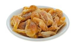 Fette secche del mandarino in una piccola ciotola immagine stock