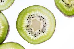 Fette trasparenti di kiwi Fotografie Stock