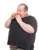 Fetter Mann, der gierig Hamburger isst Stockbilder