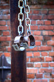 Fetters, manacles on brick background Royalty Free Stock Photo