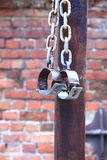Fetters, manacles on brick background Stock Photo