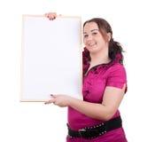 Fettes Mädchen mit unbelegtem Zeichen, Anschlagtafel Stockfotos