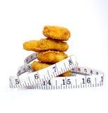 Fetthaltige Nahrungsmittelsatz auf den Pounds Stockfoto