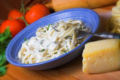 Fettuccine Alfredo. Plate of fettuccine with alfredo sauce.Parmesan and fresh pasta on a wooden board stock images