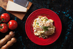 Fettuccine alfredo with grilled chicken Stock Photography