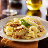 Fettuccine alfredo pasta. With grilled chicken at night time dinner royalty free stock image