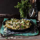 Fettuccine Alfredo with Zucchini. Bacon, Marjoram and Mint, square stock image