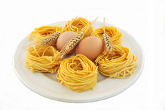 Fettuccine all 'egg and wheat ears Stock Photo