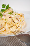 Fettuccine carbonara in a white bowl, garnished wi Stock Photography