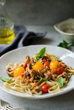 Fettuccine with Cherry Tomatoes and Mushroom sauce Stock Photo