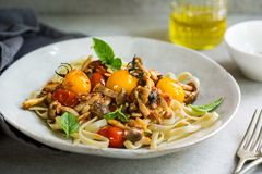 Fettuccine with Cherry Tomatoes and Mushroom sauce Royalty Free Stock Photo