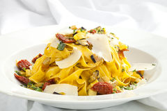 Fettuccine with dried tomatoes and parmesan Royalty Free Stock Image