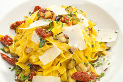 Fettuccine with dried tomatoes and parmesan Royalty Free Stock Photos