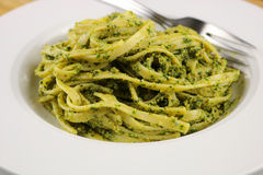 Fettuccine. With cilantro, mint and cashew pesto stock images