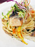 Fettuccine with grilled salmon Stock Photography