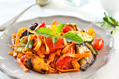 Fettuccine with grilled vegetables and tomato sauce Stock Photos
