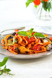 Fettuccine with grilled vegetables and tomato sauce Stock Photo