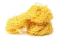 Fettuccine italian pasta isolated on white backgroun. Raw homemade pasta, isolated on white Stock Images