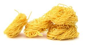 Fettuccine italian pasta isolated on white backgroun. Raw homemade pasta, isolated on white Royalty Free Stock Photos