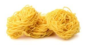 Fettuccine italian pasta isolated on white backgroun. Raw homemade pasta, isolated on white Stock Photography