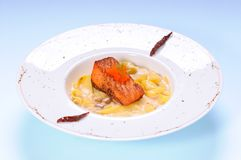 Fettuccine mushroom cream sauce with grilled salmo Stock Photo