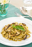 Fettuccine and mushroom with pesto Stock Photos