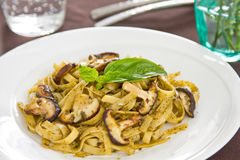 Fettuccine with mushroom in pesto sauce Royalty Free Stock Image