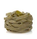 Fettuccine nest pasta. Isolated on white background Royalty Free Stock Photos
