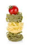 Fettuccine nest pasta with tomato cherry Royalty Free Stock Images