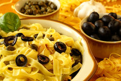 Fettuccine with olives and capers Stock Photo