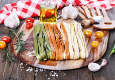 Fettuccine over rustic wooden background Stock Image