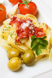 Fettuccine pasta with cherry tomato and olives Royalty Free Stock Photo