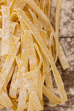 Fettuccine pasta dusted with flour Stock Photos