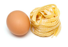 Fettuccine pasta and fresh egg Royalty Free Stock Images