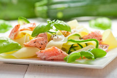 Fettuccine pasta with Salmon and zicchini Stock Images