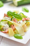 Fettuccine pasta with Salmon and zicchini Stock Photo