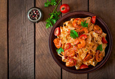 Fettuccine pasta with shrimp. Tomatoes and herbs royalty free stock photo