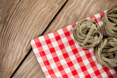 Fettuccine pasta on table cloth. Close-up of fettuccine pasta on table cloth Royalty Free Stock Photo
