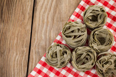 Fettuccine pasta on table cloth. Close-up of fettuccine pasta on table cloth Stock Photo