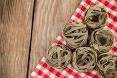 Fettuccine pasta on table cloth Stock Photo