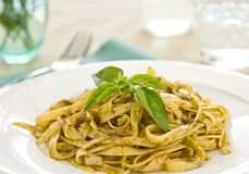 Fettuccine with pesto Stock Photography
